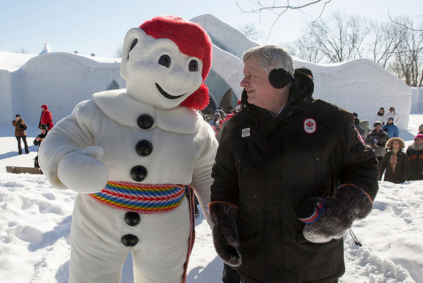 One academic cautions that election polls tend to underestimate support for the incumbent party. Photo of Prime Minister Stephen Harper with Bonhomme by pmwebphotos Flickr.